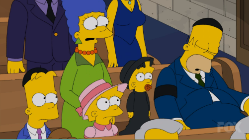 Homer naps during the funeral service